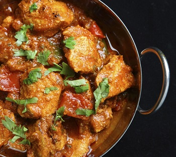 Indian chicken jalfrezi curry in balti dish